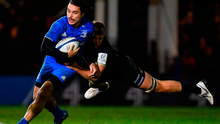 Tom Ellis performs a flying tackle on Leinster's James Lowe during yesterday's European Rugby Champions Cup game in Bath. Photo: Ramsey Cardy/Sportsfile