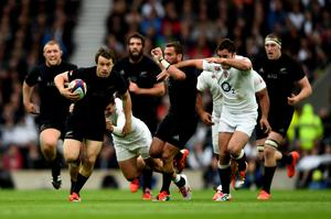 LONDON, ENGLAND - NOVEMBER 08:  Ben Smith of New Zealand breaks past Brad Barritt of England during the QBE International match between England and New Zealand at Twickenham Stadium on November 8, 2014 in London, England.  (Photo by Shaun Botterill/Getty Images)