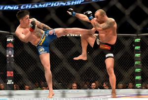 Norman Parke, left, in action against Gleison Tibau during their lightweight bout. UFC Fight Night, Norman Parke v Gleison Tibau, TD Garden, Boston, Massachusetts, USA. Picture credit: Ramsey Cardy / SPORTSFILE