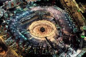 (FILES) - A file picture taken on July 16, 2015 from the Abraj al-Bait Towers shows Muslim worshipers praying at the Grand Mosque in the Muslim holy city of Mecca. A massive construction crane crashed into Mecca's Grand Mosque in stormy weather on September 11, 2015, killing more than a hundred people, less than a fortnight before the hajj pilgrimage starts. A project is currently underway to expand the area of the mosque by 400,000 square metres (4.3 million square feet), allowing it to accommodate up to 2.2 million people at once. AFP PHOTO / STR-/AFP/Getty Images