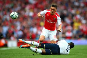 Mesut Oezil in action against Danny Rose. Paul Gilham/Getty Images