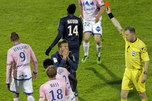 Referee Olivier Thual,shows a red card to David Beckham last night