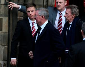Alex Ferguson and Denis Law leave  Mansfield Traquair Centre in Edinburgh after the funeral of Dave Mackay. Photo credit: Andrew Milligan/PA Wire