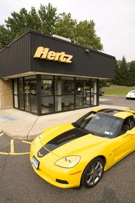 A Corvette sits outside of a Hertz rental location in Paramus, New Jersey. Photo: Bloomberg News