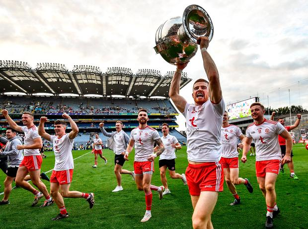 Cathal McShane of Tyrone celebrates with the Sam Maguire Cup after the All-Ireland SFC final win over Mayo. Photo by David Fitzgerald/Sportsfile
