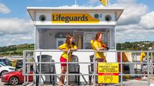 Reassuring presence: Lifeguards Carolyne O'Connor and Karen Sheehan keeping a watchful eye on swimmers from their observation station at Claycastle, Co Cork.  Picture: David Creedon/Anzenberger