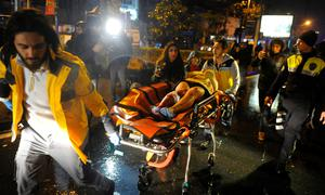 An injured woman is carried to an ambulance from a nightclub where a gun attack took place during a New Year party in Istanbul, Turkey, January 1, 2017.
