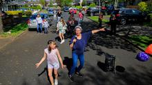 In step: Maggie Cadwell, from Maggie's Mavericks Line Dancing Club, and her daughter Siun (9) teaching their neighbours to dance in Firhouse, Dublin.  Photo: Collins