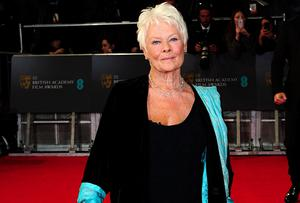 Dame Judi Dench arriving at The EE British Academy Film Awards 2014, at the Royal Opera House, Bow Street, London. PRESS ASSOCIATION Photo. Picture date: Sunday February 16, 2014. See PA story SHOWBIZ Bafta. Photo credit should read: Ian West/PA Wire