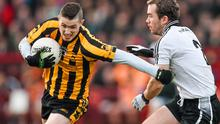 Cillian Morrison of St Eunan's takes on Hugh Gallagher during his team's defeat against Omagh St Enda's. Picture credit: Ramsey Cardy / SPORTSFILE