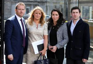 Mark and Roisin Molloy (left), and Amy Delahunt and her partner Ollie Kelly at Leinster House yesterday