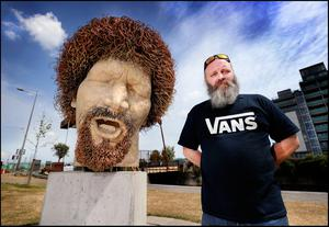 Mark Fay with the statue of Luke Kelly which has been vandalised five times