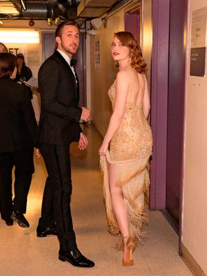 Actors Ryan Gosling (L) and Emma Stone pose backstage during the 89th Annual Academy Awards at Hollywood & Highland Center on February 26, 2017 in Hollywood, California. (Photo by Christopher Polk/Getty Images)
