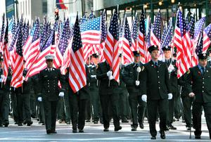 Members of the New York City Fire Department march at St. Patrick's Day Parade in New York