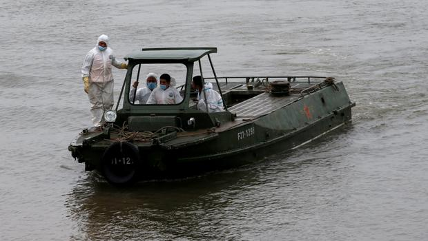 Rescue workers on a boat are seen nearby the salvaged cruise ship Eastern Star in the Jianli section of Yangtze River, Hubei province, China, June 7, 2015. REUTERS/Kim Kyung-Hoon