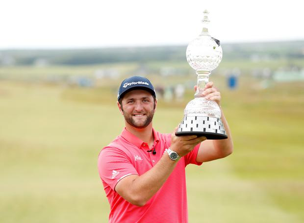 Spain's Jon Rahm poses with the trophy as he celebrates after winning the 2019 Dubai Duty Free Irish Open in Lahinch today: Photo: Action Images via Reuters/Peter Cziborra