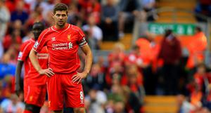 Liverpool's Steven Gerrard looks dejected during the Barclays Premier League match at Anfield