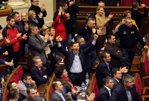 In a sign that Yanukovich is losing support in parliament, the assembly late on Thursday adopted a resolution urging the authorities to stop shooting and withdraw police forces