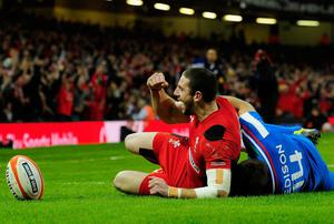 Wales wing Alex Cuthbert celebrates the opening try during the RBS Six Nations match between Wales and Italy