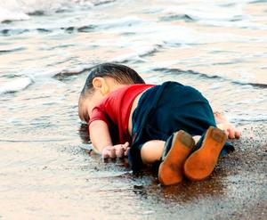 The body of little Aylan (3), who died along with his mother and five-year-old brother as they tried desperately to escape Syria for a new life in Europe, is washed up on the idyllic Turkish sands at Bodrum. Photo: Reuters