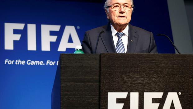 Fifa president Sepp Blatter reads a statement during a news conference at the Fifa headquarters in Zurich, Switzerland, yesterday. Photo: Reuters