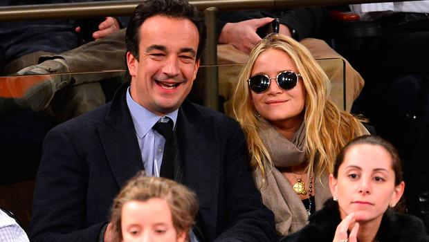 Olivier Sarkozy and Mary-Kate Olsen attend the Orlando Magic vs New York Knicks game at Madison Square Garden on March 20, 2013 in New York City.  (Photo by James Devaney/WireImage)