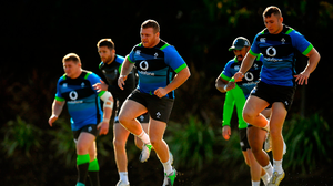 Sean Cronin, centre, and Jordan Larmour, right, during Ireland rugby squad training at St Kevin's College in Melbourne