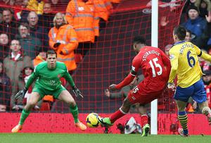 Liverpool's Daniel Sturridge scores his teams fourth goal against Arsenal at Anfield