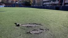 Pitch invasion: Damage to the synthetic turf at Oliver Bond flats. Photo: Mark Condren