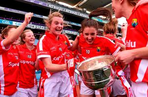 27 September 2015; Briege Corkery, left, and captain Ciara O'Sullivan, Cork, celebrate with the Brendan Martin Cup after the game. TG4 Ladies Football All-Ireland Senior Championship Final, Croke Park, Dublin. Picture credit: Paul Mohan / SPORTSFILE