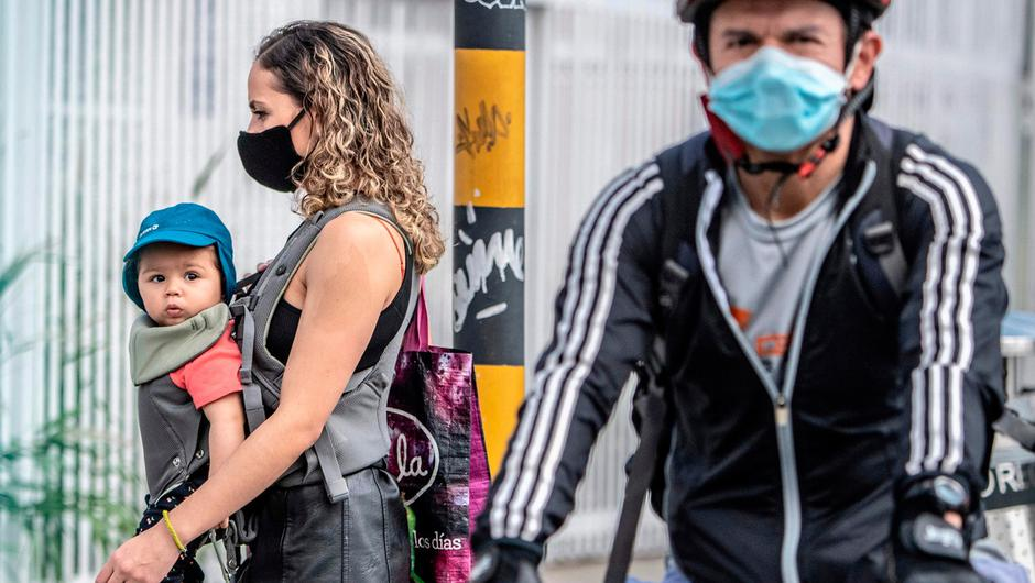 A woman wearing a face mask, as a preventive measure against the spread of coronavirus. (Photo by JUAN BARRETO/AFP via Getty Images)