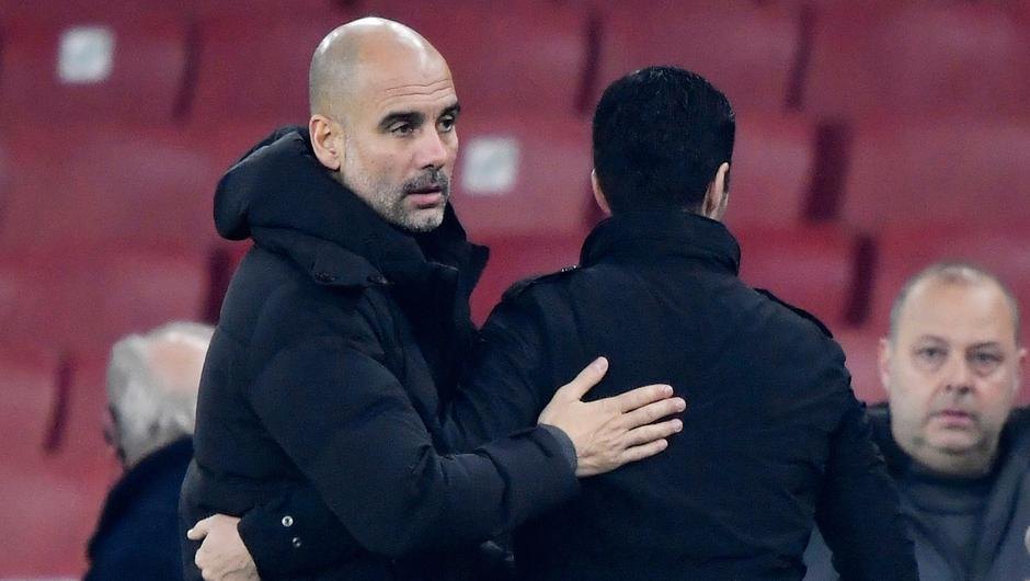 Manchester City manager Pep Guardiola with Arsenal manager Mikel Arteta. Photo: Toby Melville/Reuters
