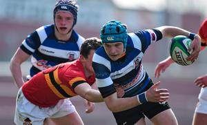 Daniel Feasey, Crescent College Comprehensive, is tackled by Robert Hedderman, CBC