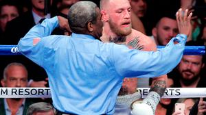 Conor McGregor v Floyd Mayweather: Referee Robert Byrd waves his arms to stop the fight