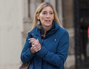 Jamie Cooper-Hohn, the estranged wife of billionaire hedge fund manager Chris Hohn, leaves the High Court after a divorce hearing. REUTERS/Peter Nicholls/Files