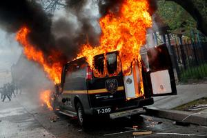 A Baltimore Metropolitan Police transport vehicle burns during clashes in Baltimore, Maryland.  Photo: Reuters