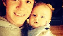 """""""Last time i seen this little man he was 4 weeks old! He is the best baby ever,"""" the star captioned a photo of himself and his godson Theo. (Instagram/Niall Horan)"""
