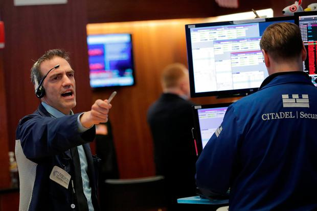 Traders work on the floor of the New York Stock Exchange shortly before the closing bell. Photo: Reuters