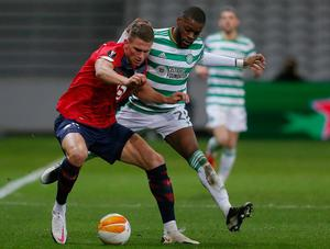 Lille's Sven Botman battles for the ball with Celtic's Olivier Ntcham. Photo: AP