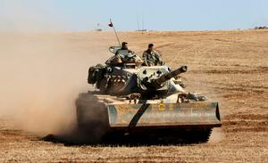 A Turkish army tank takes up position on the Turkish-Syrian border near the southeastern town of Suruc in Sanliurfa province. Reuters