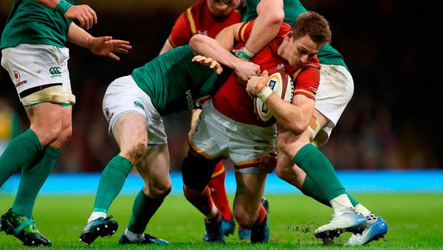 Wales' Liam Williams (centre) is tackled by Ireland's Jamie Heaslip (right)