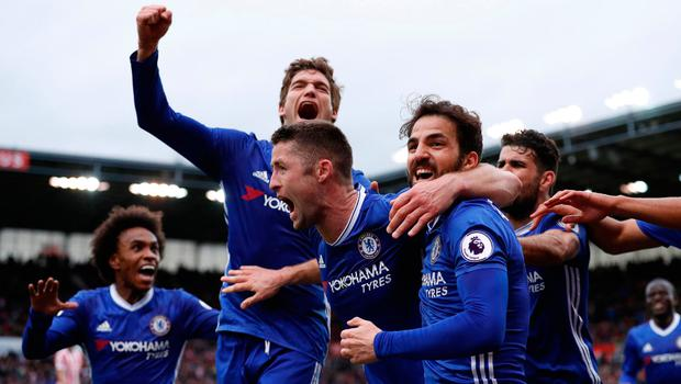 Chelsea's Gary Cahill celebrates scoring their second goal with teammates. Reuters / Phil Noble Livepic