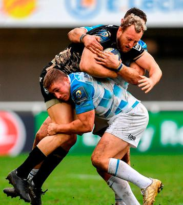 Frans Steyn of Montpellier is tackled by Jordan Larmour, right, and Robbie Henshaw of Leinster. Photo: Ramsey Cardy/Sportsfile