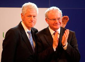 Former US President Bill Clinton with Deputy First Minister Martin McGuinness at the University of Ulster Magee campus in Derry. Photo: Paul Faith/PA Wire