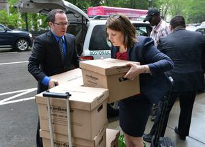 Lawyers load a cart full of documents for the trial of former Anglo Irish Bank chief executive David Drumm walk into the courthouse what may be the final  day of Drumm's US bankruptcy court trial. Pic: Josh Reynolds