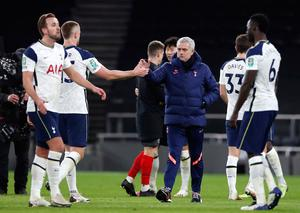 Tottenham Hotspur manager Jose Mourinho with players after the Carabao Cup semi-final win over Brentford
