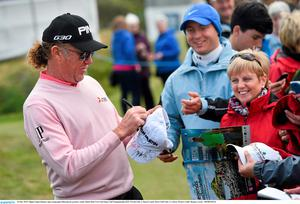 26 May 2015; Miguel ?ngel Jim?nez signs autographs following his practice round. Dubai Duty Free Irish Open Golf Championship 2015, Practice Day 2. Royal County Down Golf Club, Co. Down. Picture credit: Ramsey Cardy / SPORTSFILE