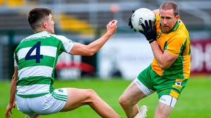 Doing it the Corofin way: Corofin veteran Gary Sice gives James Webb of Oughterard the slip during yesterday's clash. Photo: Sportsfile