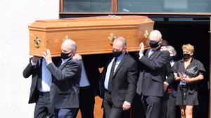 Denis Walsh's coffin is shouldered by family members from Christ the King Church, in Caherdavin, Co Limerick.  Photograph Press 22