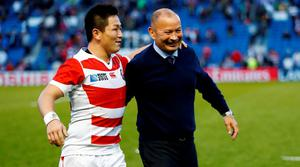 Japan head coach Eddie Jones and Kosei Ono celebrate victory after the match against South Africa Reuters / Eddie Keogh